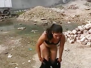 Pakistani woman taking off her clothes