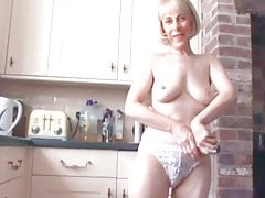 Hot MILF Pissing On Floor